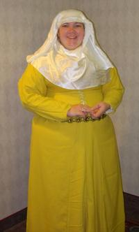 Sylvie at 12th Night in new yellow cote.